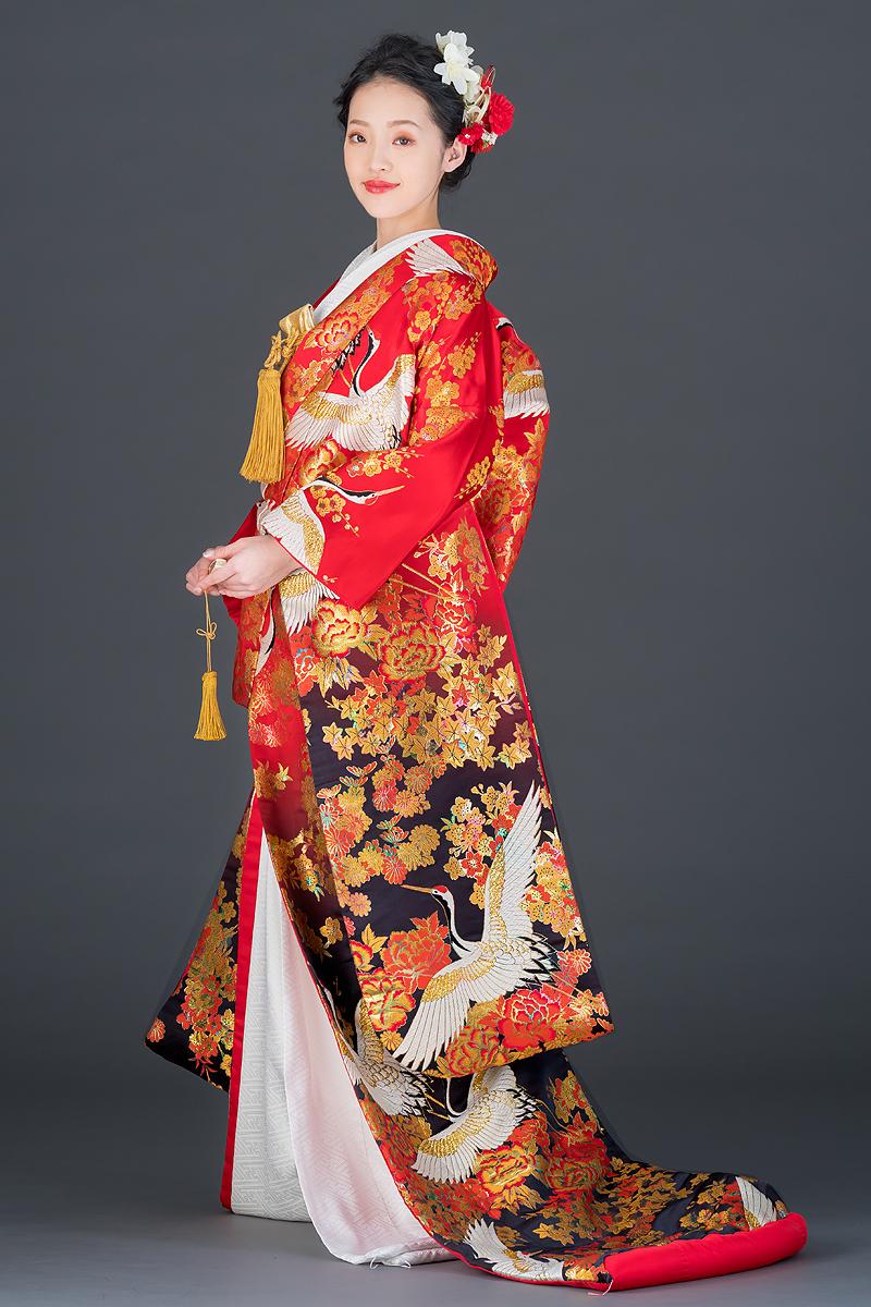 赤黒暈し四季草花に鶴